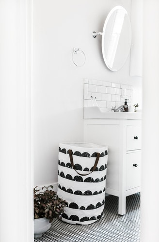 Sleek Bathroom with Laundry Basket